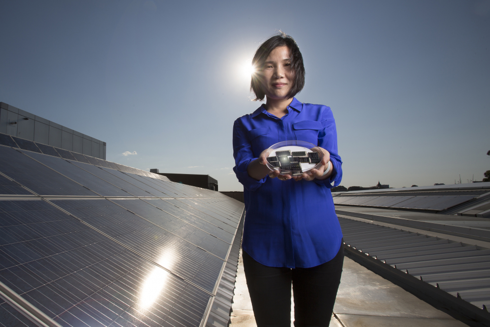Dr Xiaojing Hao of UNSW's Australian Centre for Advanced Photovoltaics holding the new CZTS solar cells.