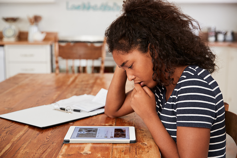 Having the device in a visible place, like the kitchen or dining room, can help parents monitor their child's online activities. Image: Shutterstock