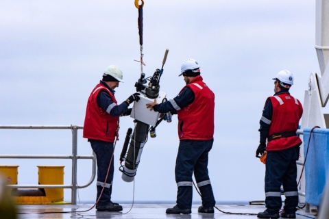 Crew on a ship prepare to drop an Argo float into the sea