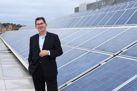 ian_jacobs_with_solar_pv_arrays_installed_across_rooftops_at_the_unsw_kensington_campus.jpg