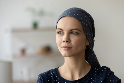 Woman who recently underwent cancer treatment wearing a headscarf