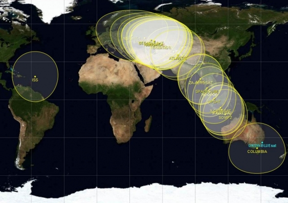A NORAD map with the location of the international Space Station (left circle), and the QB50 constellation of 28 satellites (right) in orbit above Earth.