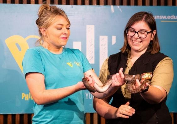 Art student organiser Courtney Cross with snake
