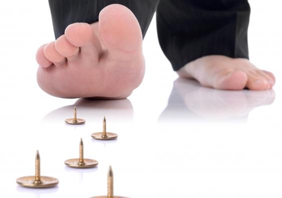 15_man_stepping_on_pins.jpg