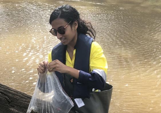 Tashya Miranda at work taking water samples