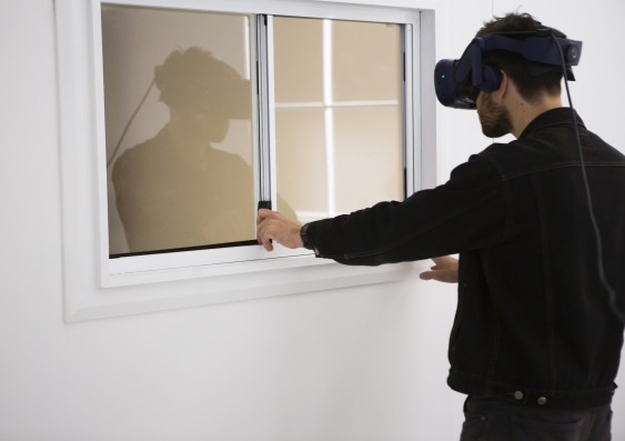 Man using VR goggles for The Edge of the Present, an immersive VR experience Photo - Alex Davies