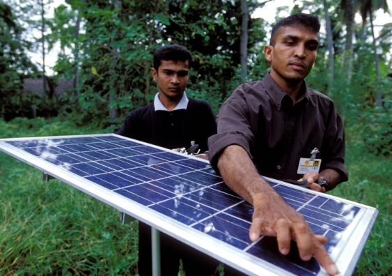 Solar panels used for lighting village homes in Sri Lanka. Image ...