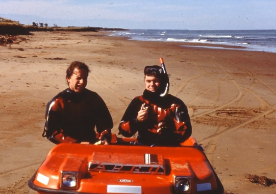 Rob Brander and Phil Osborne eating donuts in a beach buggy