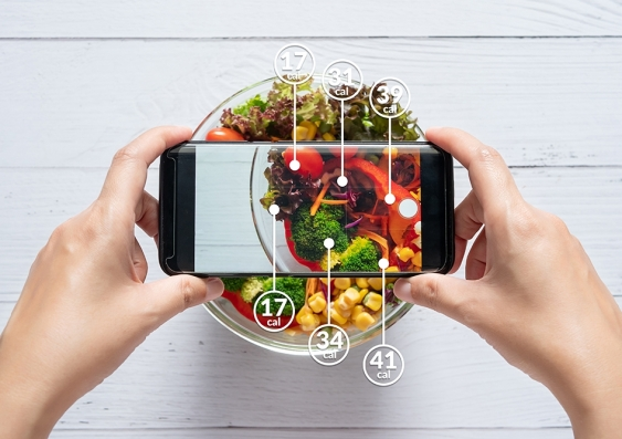 Stylised image of a mobile phone measuring the calories in a salad
