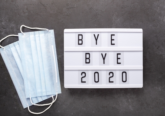 A lightbox with message 'bye bye 2020' alongside two surgical masks