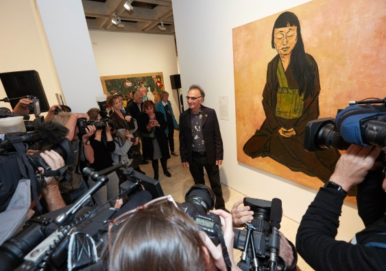 Tony Costa with his Archibald Prize-winning portrait