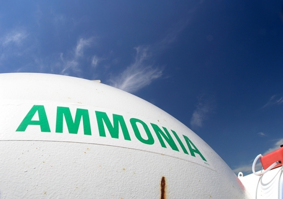 A tank of ammonia at a chemical plant with blue sky in background.