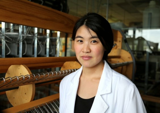 Joanna Ng with the weaver's loom. Photo: Leilah Schubert / UNSW Media