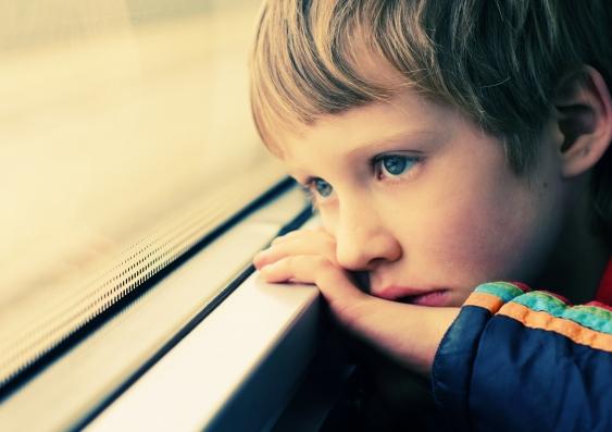 8_boy_looking_out_window_autism.jpg
