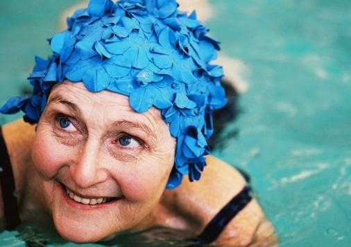 Happy older woman in pool for CHeBA story 1