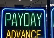 Payday advance sign inside