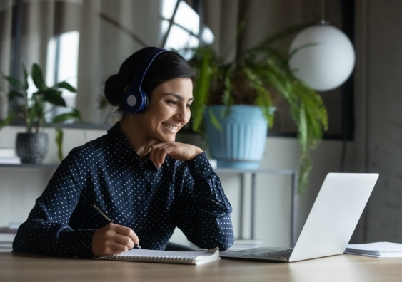 A woman smiling on a call working from home