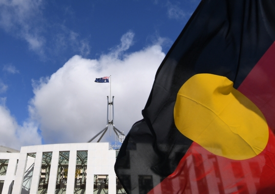 aboriginal flag and australian flag flying at parliament house canberra