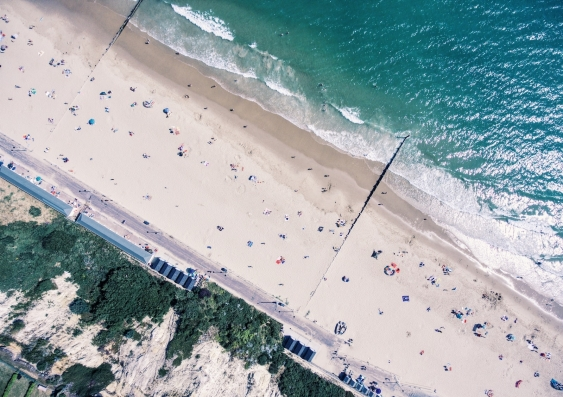 aerial drone shot of a beach with people