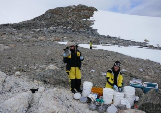 Researchers work on soil samples in Antarctica