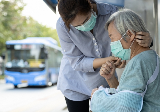 assisting elderly lady on the street