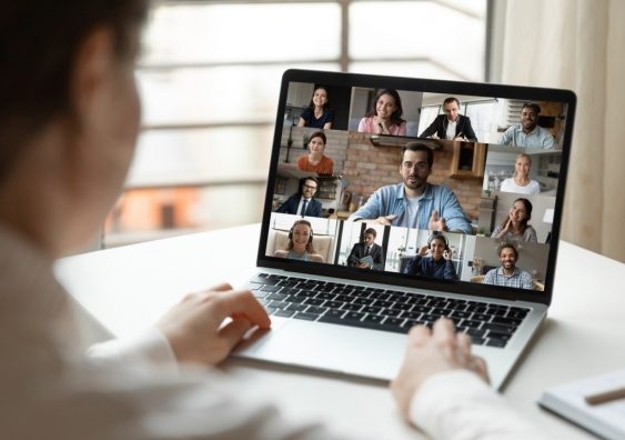 Employee involved in a video conference with manager and coworkers