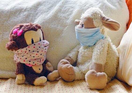 Children's plush toys wearing face masks