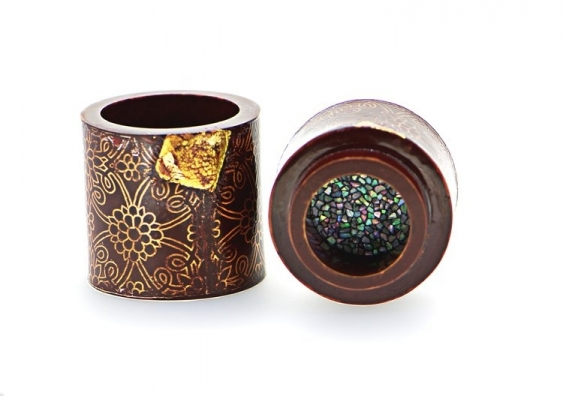 Art vessels showcasing floral motifs and jewelled inlay