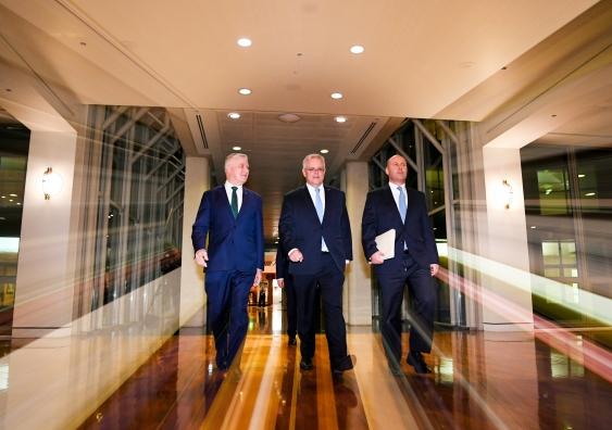 Politicians walking through Parliament House