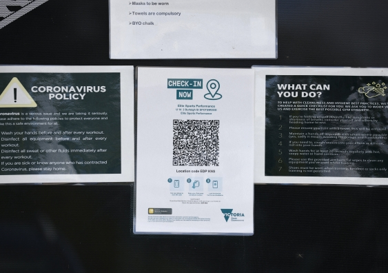 A QR code check in outside a business