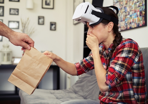 Woman feeling nauseous while wearing a virtual reality headset