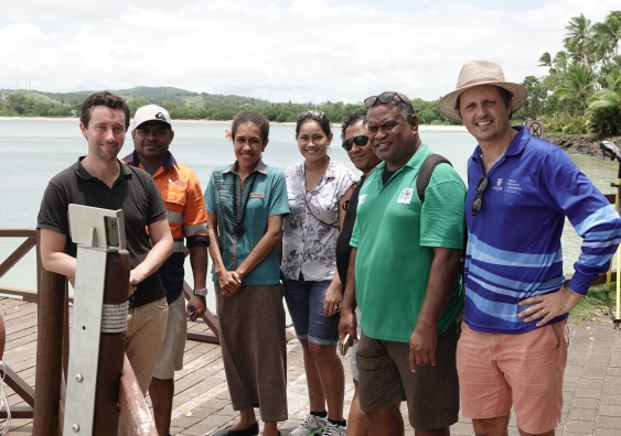 Dr Mitchel Harley (far right) at the installation of a CoastSnap station in Fiji. Credit Navneet Lal