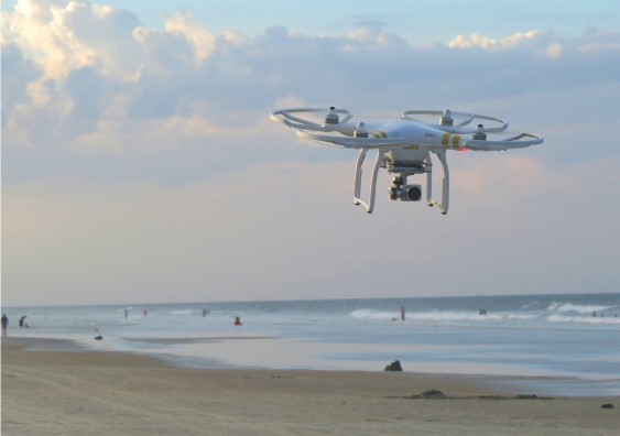 drone flying on the beach