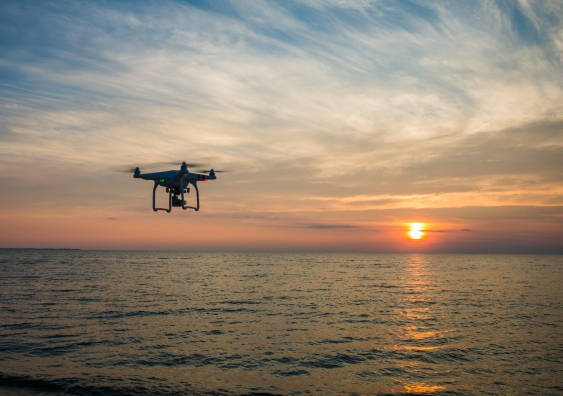 drone flying on the beach at sunset
