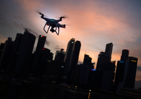 drone flying over city at dusk