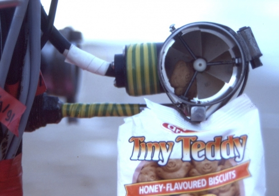 A packet of Tiny Teddies connected to surveying equipment