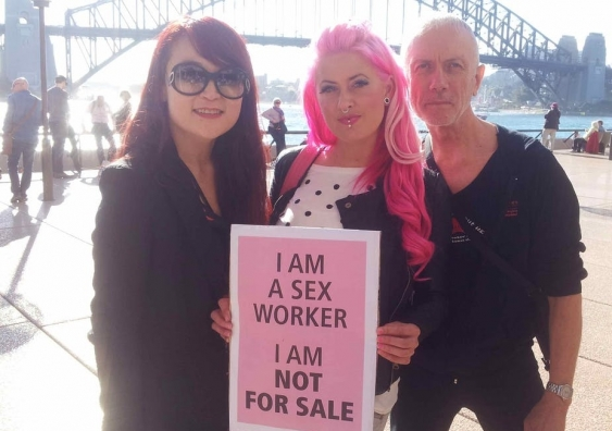 Jules Kim, Zahra Stardust and Cameron Cox standing outside in front of the Harbour Bridge