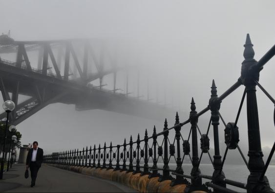 sydney harbour bridge surrounded by fog