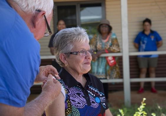A woman receives a vaccine at an Aboriginal Medical Service Centre