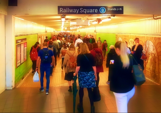 people in railway square tunnel