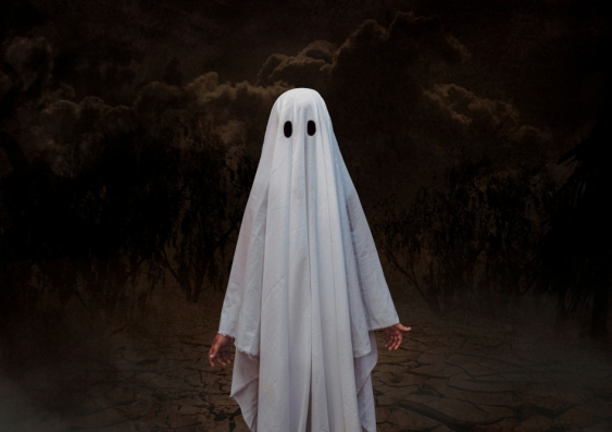 Person in a simple sheet ghost costume