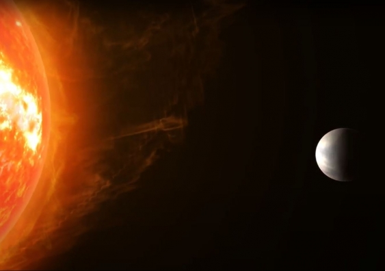 Artist's impression of the planet Gliese 486b orbiting its star
