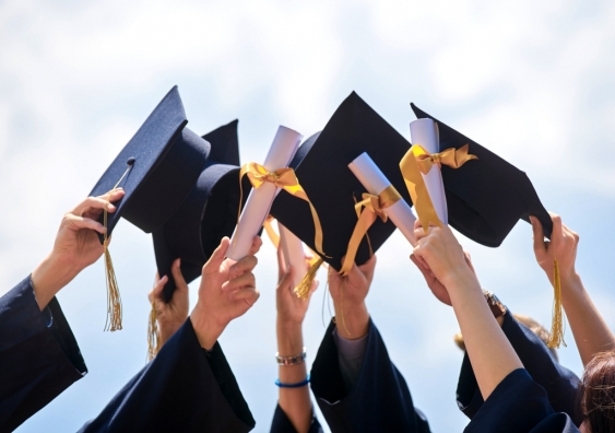 Graduation caps being thrown in the air