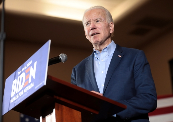 Joe Biden speaking at a lecturn on the campaign