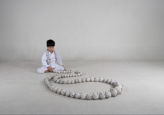 Child wearing Daijuzu (Large Prayer Beads) (2019), Guy Keulemans & Kyoko Hashimoto. Photo: Romon Yang