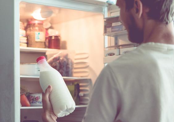 Man checking milk bottle
