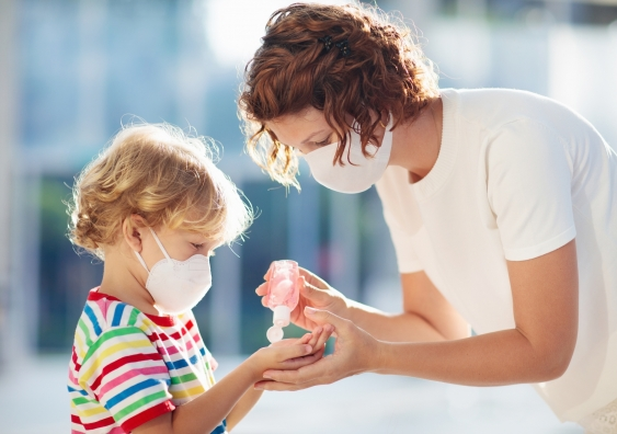 A mother and child wear face masks during the COVID-19 outbreak.