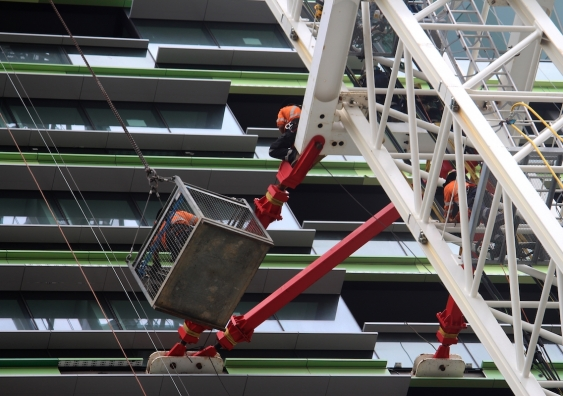 opal_tower_workers_on_a_crane_outside_the_building.jpg