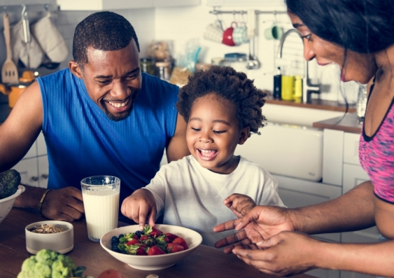 Parents encouraging healthy eating habits