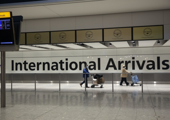 people walking through airport arrivals